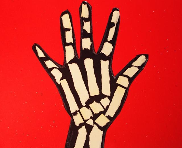 Torn Paper Skeleton Hand