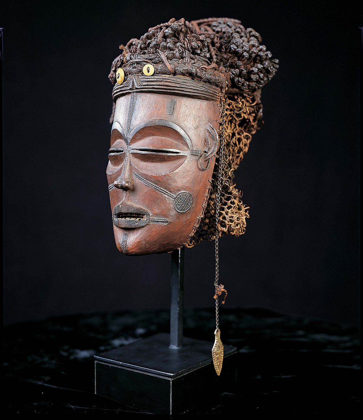 The image depicts the African Mwana Pwo mask featured in this Object of the Month presentation.