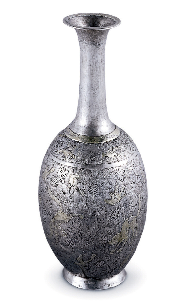 The featured artwork for this lesson is a Chinese Tang Dynasty Ritual Bottle, dating to the early eighth century, CE